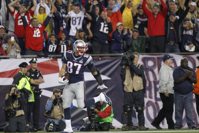 New England Patriots tight end Rob Gronkowski runs into the end zone on a 16-yard reception in the second quarter against the Pittsburgh Steelers at Gillette Stadium in Foxborough, Mass., Thursday night. Photo by Matthew Healey/ UPI