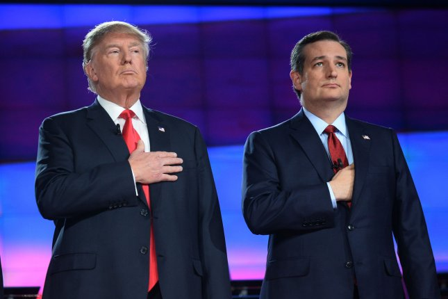(L-R) Donald Trump and Ted Cruz assemble for a photo-op prior to the fifth Republican presidential candidates' debate at the Venetian Hotel & Casino in Las Vegas, Nevada on December 15, 2015. The top 9 candidates squared off in the first-tiered debate on the main stage. Photo by Jim Ruymen/UPI