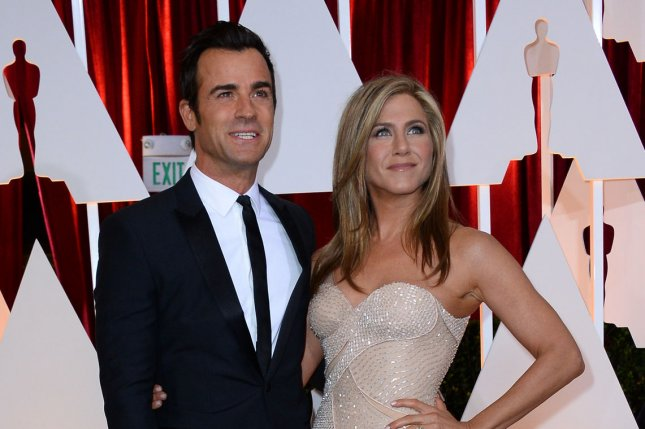 Jennifer Aniston (R) and Justin Theroux at the Academy Awards on February 22, 2015. File Photo by Jim Ruymen/UPI