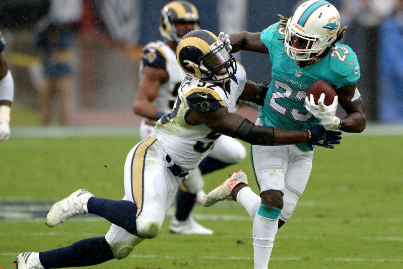Los Angeles Rams linebacker Alec Ogletree (52) tackles Miami Dolphins running back Jay Ajayi (23) at the LA Coliseum on November 20 in Los Angeles, Calif. File photo by Jon SooHoo/UPI