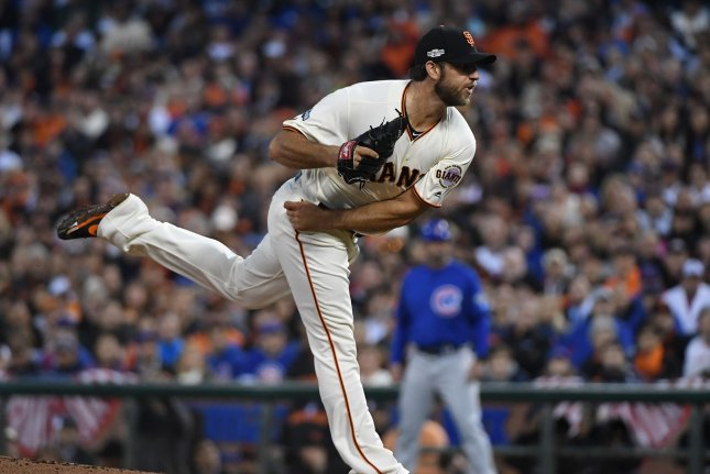 San Francisco Giants starting pitcher Madison Bumgarner delivers to the Chicago Cubs during the first inning. File photo by Terry Schmitt/UPI