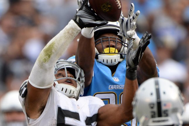 Former Oakland Raiders linebacker Malcolm Smith (L) breaks up a pass to San Diego Chargers receiver Ladarius Green in the third quarter at Qualcomm Stadium in San Diego on October 25, 2015. File photo by Jon SooHoo/UPI