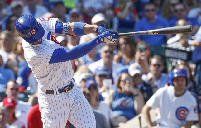 Chicago Cubs batter Kris Bryant hits a solo home run off St. Louis Cardinals pitcher Carlos Martinez in the fourth inning at Wrigley Field on Friday. Photo by Kamil Krzaczynski/UPI
