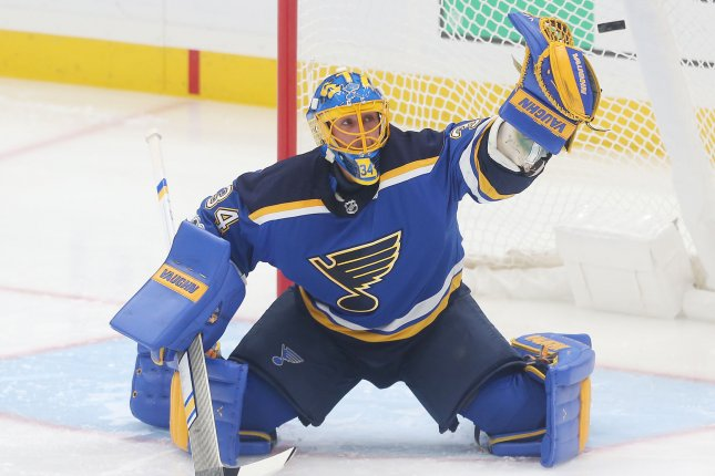 St. Louis Blues goaltender Jake Allen knocks the puck away after a shot by the Los Angeles Kings in the first period at the Scottrade Center on Monday in St. Louis, Mo. Photo by Bill Greenblatt/UPI