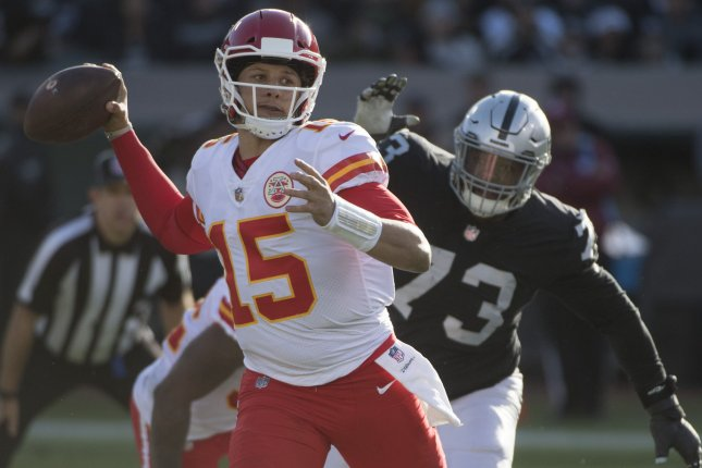 Kansas City Chiefs quarterback Patrick Mahomes (15) throws under pressure from Oakland Raiders defender Maurice Hurst (73) in the second quarter on Sunday at the Coliseum in Oakland. Photo by Terry Schmitt/UPI