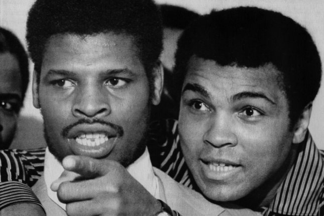 Leon Spinks (L) fought Muhammad Ali (R) twice in 1978, scoring an upset in his first bout, before Ali won the rematch seven months later. File Photo by Pat Benic/UPI