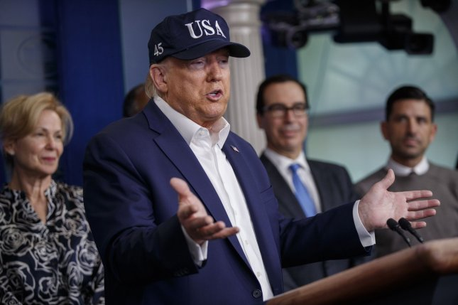 President Donald Trump, joined by members of the White House Coronavirus Task Force, speaks during a briefing at the White House on Saturday. Photo by Shawn Thew/UPI