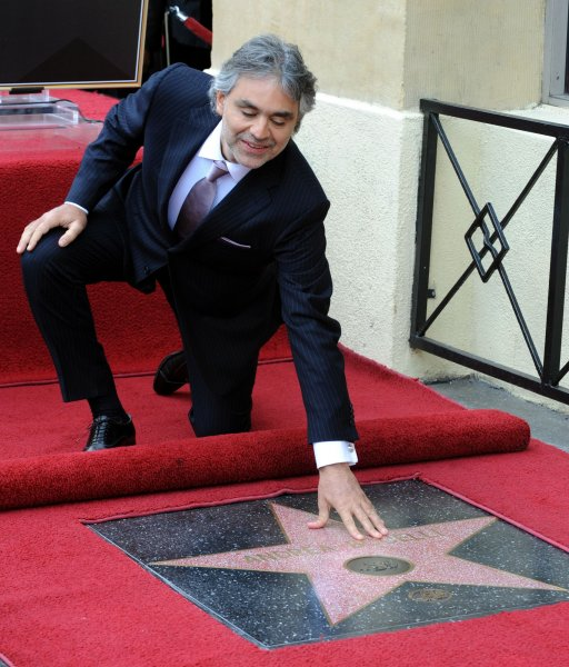 Italian tenor Andrea Bocelli touches his star during an unveiling ceremony honoring him with the 2,402nd star on the Hollywood Walk of Fame in Los Angeles on March 2, 2010. UPI/Jim Ruymen