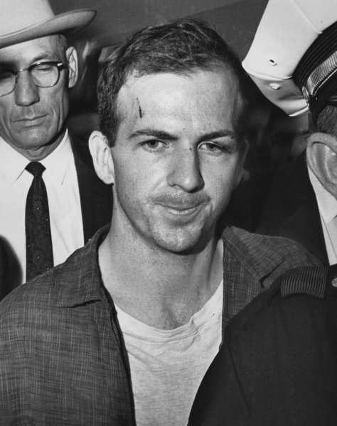 Twenty-four year old ex-Marine Lee Harvey Oswald after his arrest on November 22, 1963. He received a cut on his forehead and a blackened swollen left eye in a scuffle with officers who arrested him. Oswald, an avowed Marxist, has been charged with the murder of President John F. Kennedy, who was killed by a sniper's bullet as he rode in a motorcade through Dallas. (UPI Photo/Files)