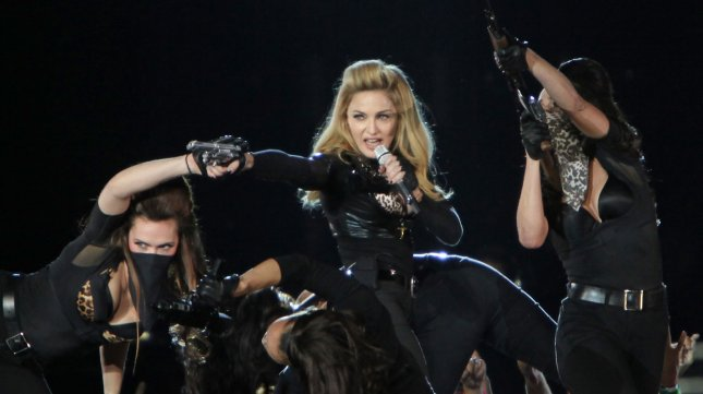Madonna ignores police warnings to cut fake guns from show
