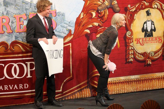 Hasty Pudding Theatricals 2014 Woman of the Year actress Helen Mirren (R) twerks for Harvard junior Bobby Flitsch, playing the part of 'Tony Blair' during her roast inside Farkas Hall at Harvard University in Cambridge, Massachusetts on January 30, 2014. UPI/Matthew Healey