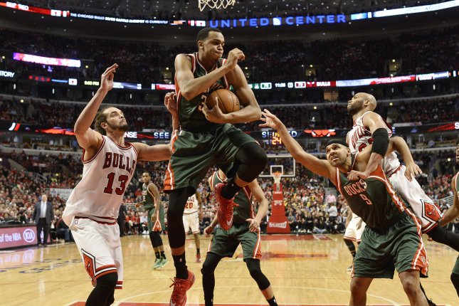 Milwaukee Bucks center John Henson (C) grabs a rebound from Chicago Bulls center Joakim Noah (L) as Bucks forward Jared Dudley boxes out Bulls forward Taj Gibson (R) during the fourth quarter of game 5 the first round of the NBA Playoffs at the United Center on April 27, 2015 in Chicago. The Bucks won 94-88 to force a game 6 as the Bulls lead the series 3-2. Photo by Brian Kersey/UPI