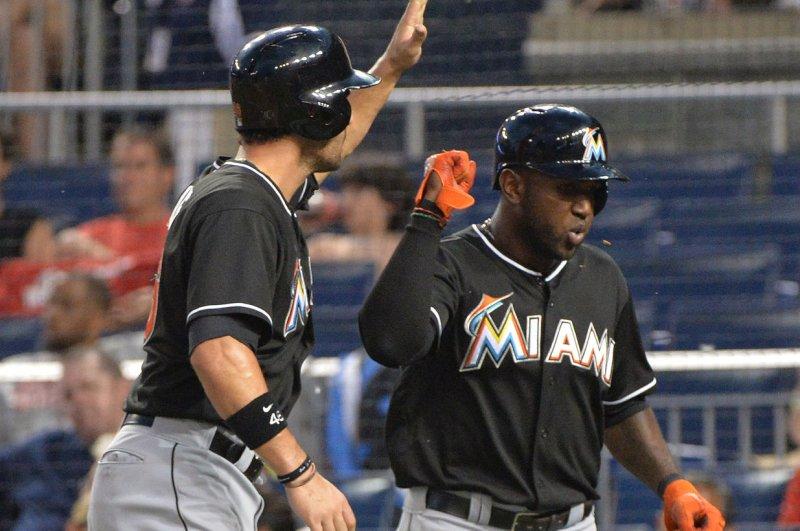 Miami Marlins' Garrett Jones (L) and Marcell Ozuna. UPI/Kevin Dietsch