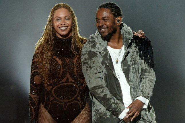 Beyonce and Kendrick Lamar smile after performing onstage during the 16th annual BET Awards on June 26, 2016. Beyonce and Lamar join Radiohead as the headlining acts for Coachella 2017. File Photo by Jim Ruymen/UPI