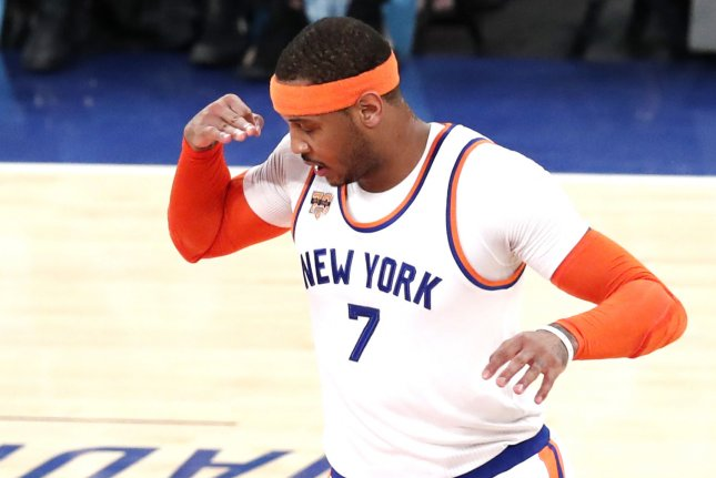 Former New York Knicks Forward Carmelo Anthony Reacts After Hitting A 3 Point Shot In The First Half Against The Charlotte Hornets On January 27 At Madison
