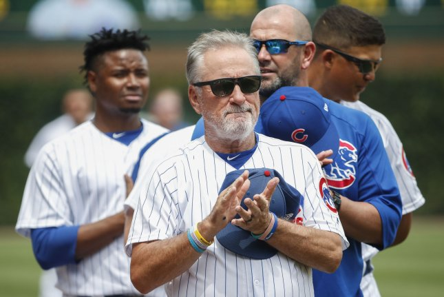 Chicago Cubs manager Joe Maddon stands during the national anthem before a baseball game against the San Diego Padres on Sunday at Wrigley Field in Chicago. Photo by Kamil Krzaczynski/UPI