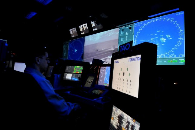 Staff watch radar screens in the CDC (Combat Direction Center) on the USS George Washington during the Keen Sword 2010 U.S.-Japan joint military exercise in the Pacific Ocean east of Okinawa island, Japan, on December 10, 2010. UPI/Keizo Mori