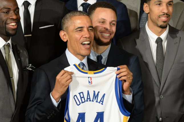 President Barack Obama visited with Stephen Curry (right center) and the Golden State Warriors in 2016 after the team won the NBA Finals. Curry and Obama have remained friends and spoke together at a My Brother's Keeper Alliance event Tuesday in Oakland, Calif. File Photo by Pat Benic/UPI