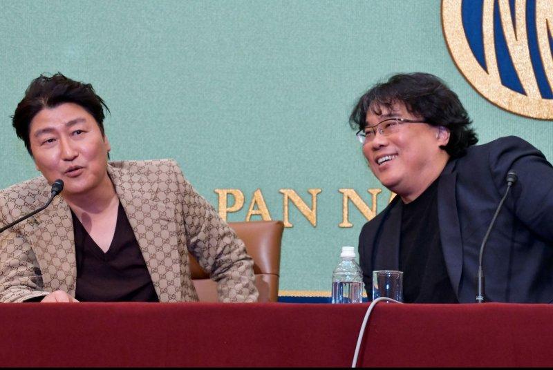 Parasite star Song Kang-ho (L) and director Bong Joon-ho, attend a press conference in Tokyo, Japan, on Sunday. Photo by Keizo Mori/UPI