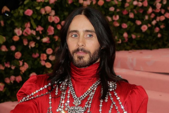Jared Leto has long hair and wears a hospital gown as Joker in teaser photos for Zack Snyder's Justice League. File Photo by John Angelillo/UPI