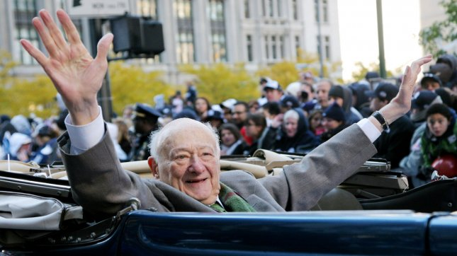 Former New York City Mayor Ed Koch waves to the crowds as he rides in a car during the ticker-tape parade where the New York Yankees are honored for their World Series win on November 6, 2009 in New York City. UPI Photo/Monika Graff