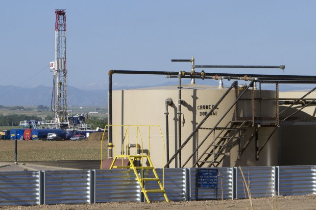A drilling rig operates on farmland near a storage tank at the Niobrara oil shale formation in Weld County, Northeastern Colorado. Gas and oil companies are using large amounts of water to obtain shale oil and gas in a process called hydraulic fracturing, or fracking. File photo by Gary C. Caskey/UPI