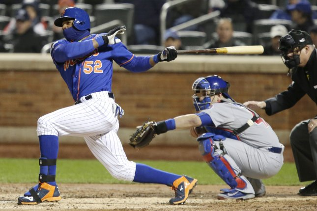 New York Mets Yoenis Cespedes hits an RBI single in the 3rd inning in game two of the NLCS against the Chicago Cubs at Citi Field in New York City on October 18, 2015. Photo by John Angelillo/UPI