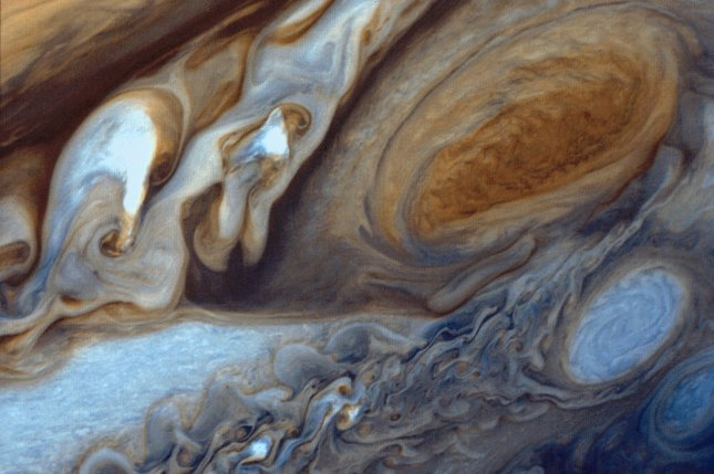 New research suggests the cyclone-like storm on Jupiter known as the Great Red Spot fuels surprisingly high temperatures in the gas giant's upper atmosphere. Photo by UPI/NASA