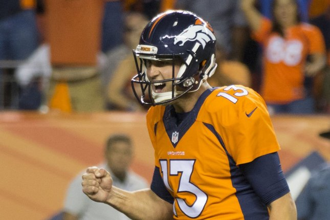 Denver Broncos quarterback Trevor Siemian celebrates game-winning touchdown against the Carolina Panthers on September 8, 2016. The Broncos' offense continues to develop under Siemian but the scoring output has been impressive, courtesy in large part to a strong defense. Photo by Gary C. Caskey/UPI