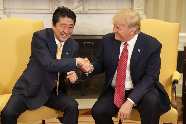 U.S. President Donald Trump (R) and Japanese Prime Minister Shinzo Abe shake hands before bilateral meetings in the Oval Office at the White House on Friday in Washington, D.C. Trump and Abe are expected to discuss many issues, including trade and security ties and will hold a joint press confrence later in the day. Pool Photo by Chip Somodevilla/UPI