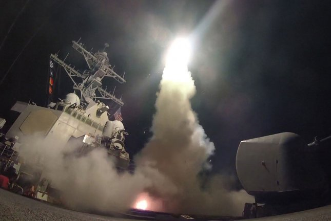 The guided-missile destroyer USS Porter (DDG 78) conducts strike operations while in the Mediterranean Sea early Friday morning, after President Donald Trump ordered 59 Tomahawk cruise missiles to attack a west Syrian airfield where it's believed President Bashar al-Assad's regime launched this week's deadly chemical attack on civilians near Aleppo. Photo by U.S. Navy/MCS 3rd Class Ford Williams/UPI