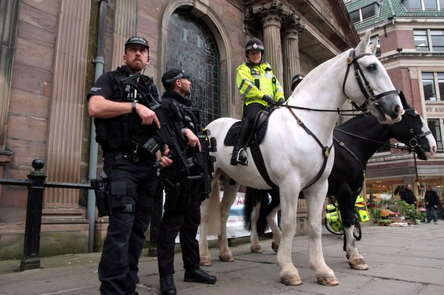 Armed police patrol a street in central Manchester, Britain, on Wednesday following a bombing at the Manchester Arena. British authorities have resumed sharing intelligence with the U.S. after a suspension due to leaks of confidential information. Photo by Mushtaq Mohammed/UPI