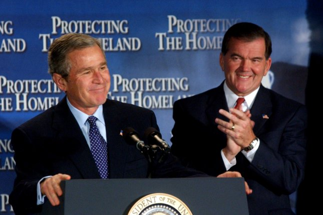 President George W. Bush shares a laugh with Homeland Security Director Tom Ridge on November 12, 2002, one week before Congress voted to create the Cabinet-level Department of Homeland Security. Ridge became the first secretary of the department. File Photo by Michael Kleinfeld/UPI