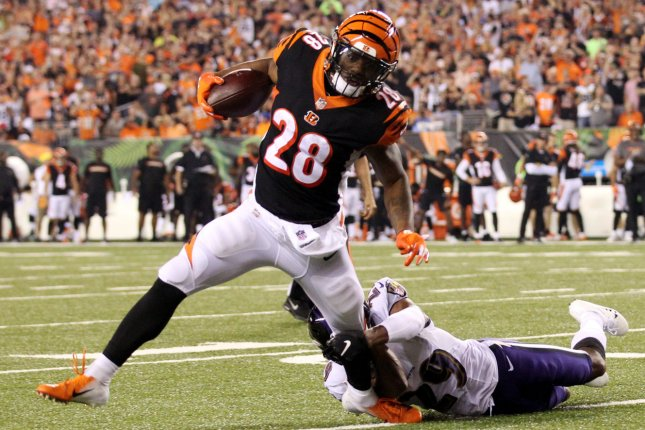 Cincinnati Bengals running back Joe Mixon (28) is tackled by Baltimore Ravens defender Marlon Humphrey (29) during the first half of play on September 13 at Paul Brown Stadium in Cincinnati. Photo by John Sommers II/UPI