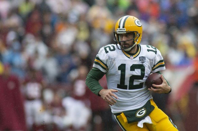 Green Bay Packers Quarterback Aaron Rodgers 12 Scrambles With The Football During An NFL Week 3 Game Between Washington Redskins And