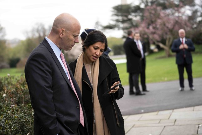 Marc Short, chief of staff for Vice President Mike Pence talks with Katie Miller, the press secretary for Pence, appear in the Rose Garden of the White House on March, 24. Shorted tested positive for coronavirus Saturday and Miller in May. File Photo by Doug Mills/UPI