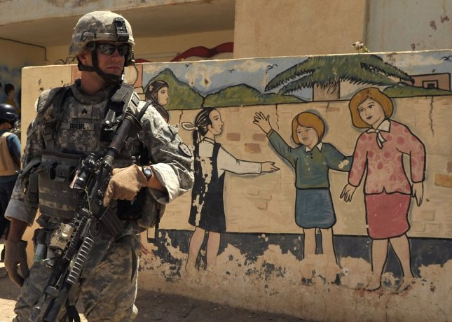 U.S. Army Sgt. David Diehl, of Alpha Company, 1st Battalion, 21st Infantry Regiment, provides security outside a school in Baqubah, Iraq, July 19, 2010. U.S. and Iraqi forces worked together to provide aid to schools and other organizations throughout the Diyala province of Iraq. UPI/Ted Green/US Navy