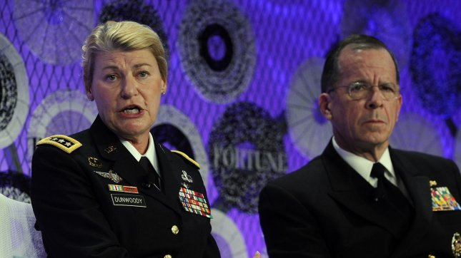 Gen. Ann Dunwoody, commanding general at the U.S. Army Material Command and the nation's first female four star general, and Chairman of the Joint Chiefs of Staff Adm. Michael Mullen participate in Fortune's Most Powerful Women Summit in Washington on October 6, 2010. UPI/Roger L. Wollenberg