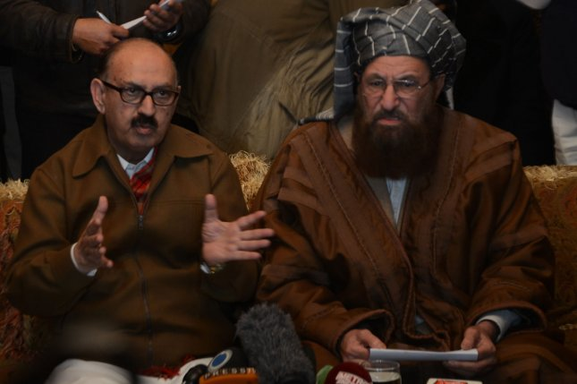 Tehrik-e-Taliban Pakistan (TTP) committee member and senior religious party leader Maulana Sami-ul-Haq (R) looks on as Special Assistant to Pakistan's prime minister Irfan Siddiqui (L) speaks during a joint press conference following their meeting at the Khyber Pakhtunkhwa Housen in Islamabad, Pakistan on February 6, 2014. (UPI/Sajjad ALi Qureshi)