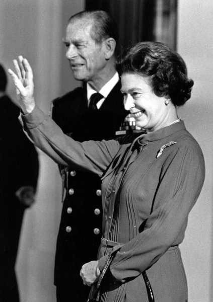 Queen Elizabeth II and Prince Philip are shown at Buckingham Palace Oct. 26, 1984. (UPI Photo/Pool/Files)