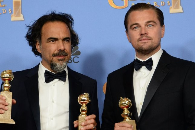 Writer/director Alejandro Gonzalez Inarritu, left, and actor Leonardo DiCaprio, winners of the award for Best Motion Picture - Drama for The Revenant appear backstage during the 73rd annual Golden Globe Awards on January 10, 2016. File Photo by Jim Ruymen/UPI