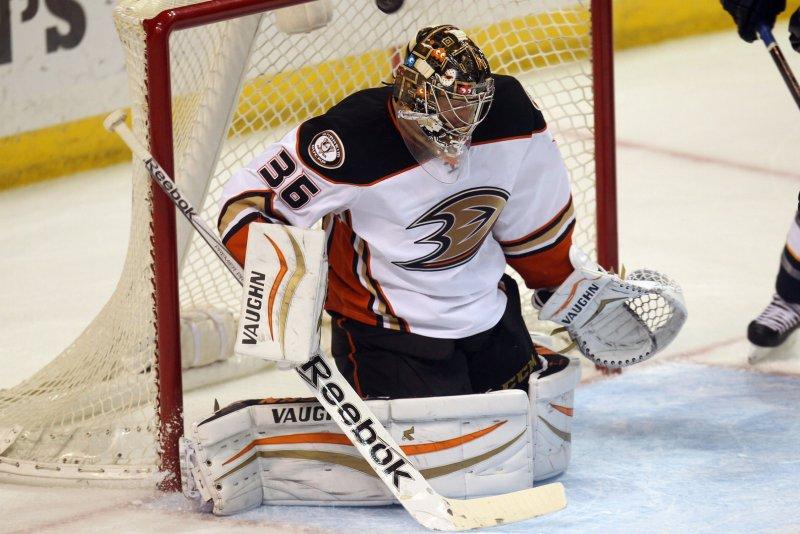 Anaheim Ducks goaltender John Gibson loses track of the puck. File photo by Bill Greenblatt/UPI