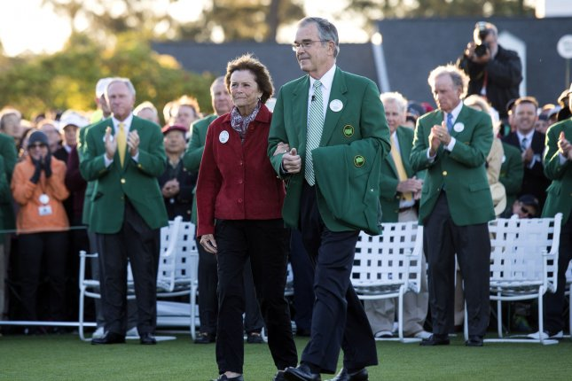 Augusta National Chairman Billy Payne (R) and Kathleen Palmer, the wife of the late Arnold Palmer, walk together to place Palmer's green jacket at the the ceremonial first tee shot on the first day of the 2017 Masters Tournament at Augusta National Golf Club in Augusta, Georgia on April 6, 2017. File photo by Kevin Dietsch/UPI