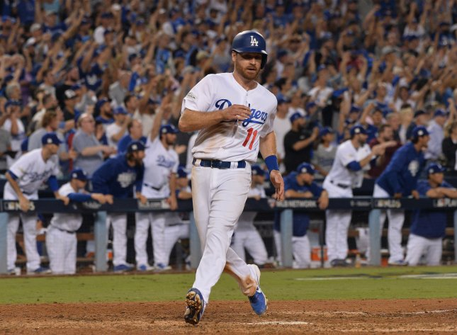 The Los Angeles Dodgers' Logan Forsythe scores on teammate Chris Taylor's bases-loaded single in the seventh inning against the Arizona Diamondbacks during Game 2 of the NLDS on Saturday. Photo by Jim Ruymen/UPI
