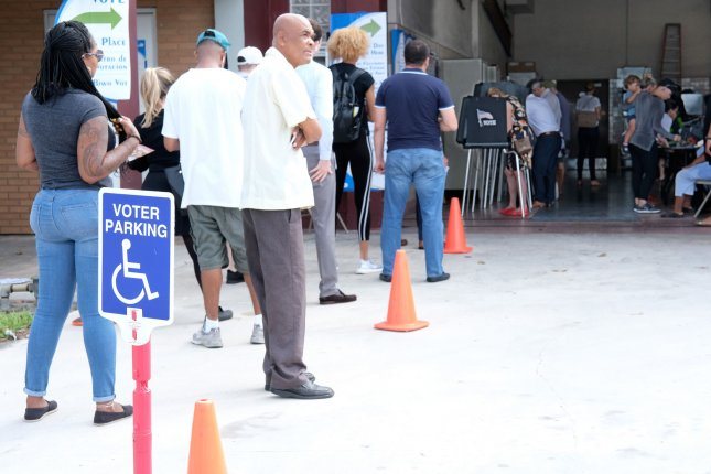 Florida residents line up to cast ballots in Miami. Photo by Gary I Rothstein/UPI