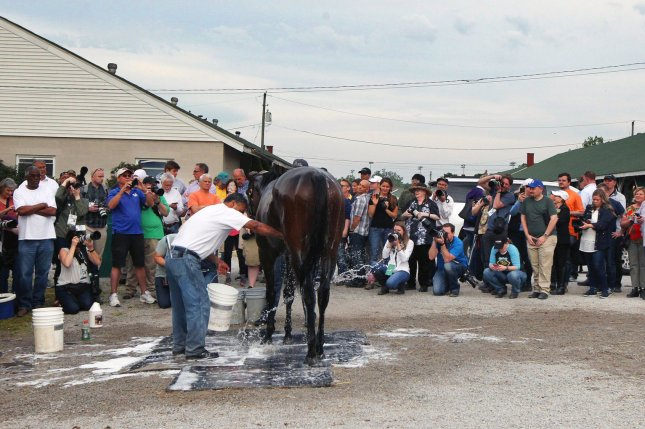 Racing fans watch as Kentucky Derby favorite Omaha Beach is washed after his morning workouts as preparations continue for the 145th running of the Kentucky Derby at Churchill Downs on Saturday in Louisville. Photo by John Sommers II/UPI