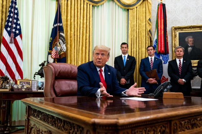 President Donald Trump addresses reporters in the Oval Office of the White House after receiving a briefing from law enforcement on indictments against MS-13 gang members in Washington, D.C., on Wednesday. Photo by Anna Moneymaker/UPI