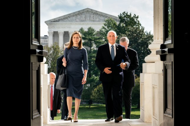 Judge Amy Coney Barrett and Vice President Mike Pence are pictured Tuesday as they ascend the steps of the U.S. Capitol in Washington, D.C. Photo by Erin Schaff/UPI/Pool