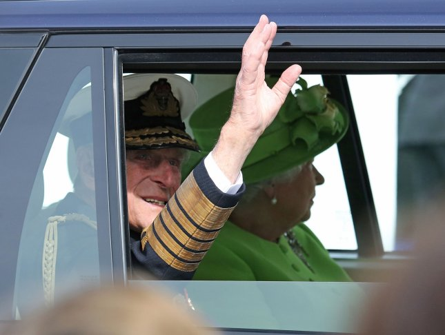 Prince Philip, duke of Edinburgh and Britain's Queen Elizabeth II leave Sword Beach in Ouistreham after the ceremony commemorating the 70th anniversary of the D-Day landings in the Normandy region of France on June 6, 2014. The duke will remain hospitalized for several more days for an unspecified infection. File Photo by David Silpa/UPI