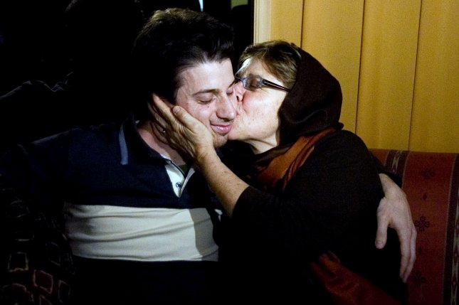Jailed American Josh Fattal gets a kiss from his mother Laura Fattal during a reunion at a hotel in northern Tehran, Iran on May 20, 2010. The mothers of the three jailed Americans arrived on Wednesday in Tehran and was received by the ambassador of the Swiss embassy,which represents the interests of the U.S. with Iran. UPI/Maryam Rahmanian